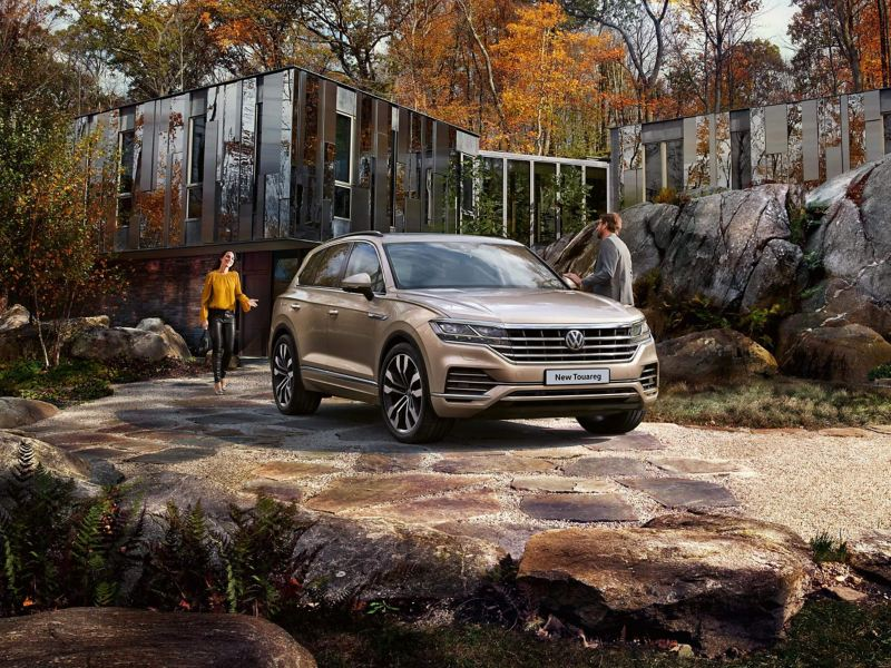 Volkswagen New Touareg parked by a cabin