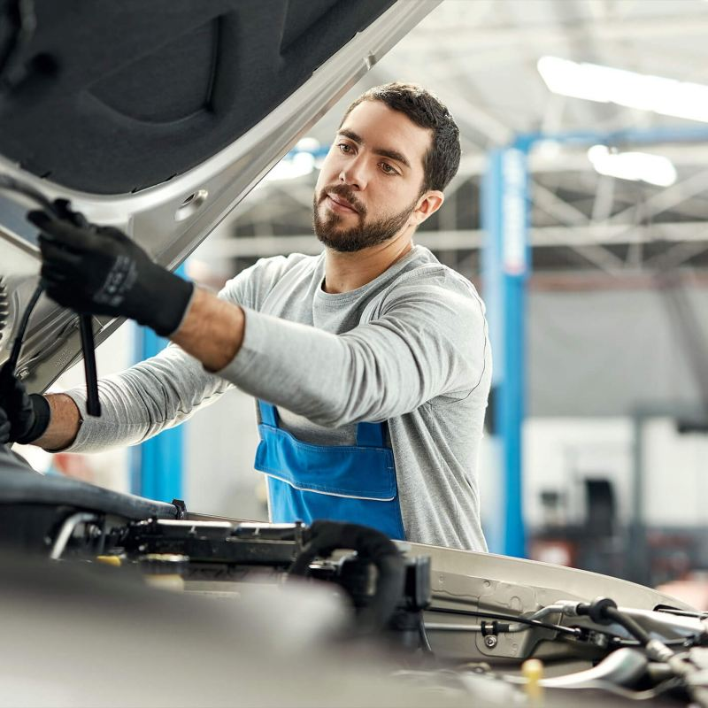 Mechanic inspecting engine