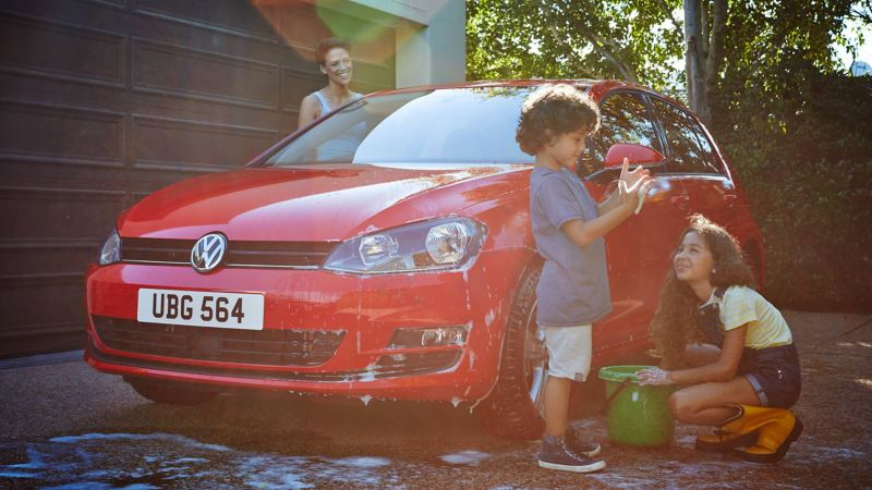 Family washing Volkswagen car