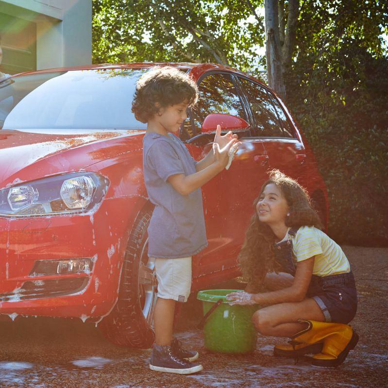 Family washing Volkswagen car