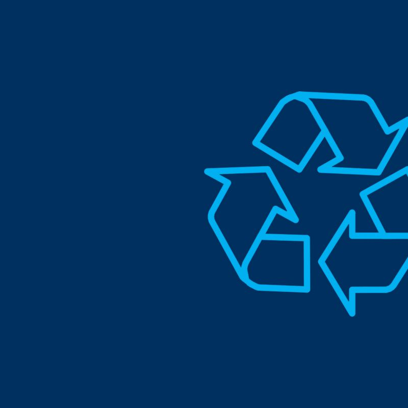 recycle symbol on a blue background