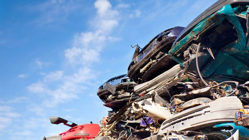 Scrapped cars piled high