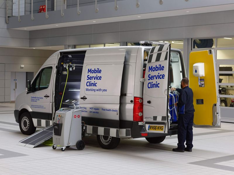 Mobile Servicing van in garage with mechanic