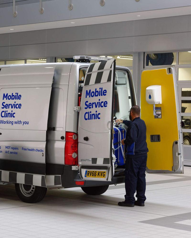 Mobile Servicing van in garage with mechanic