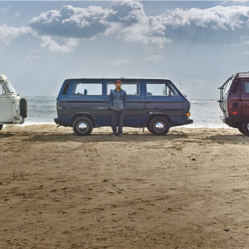 Three camper vans on the beach