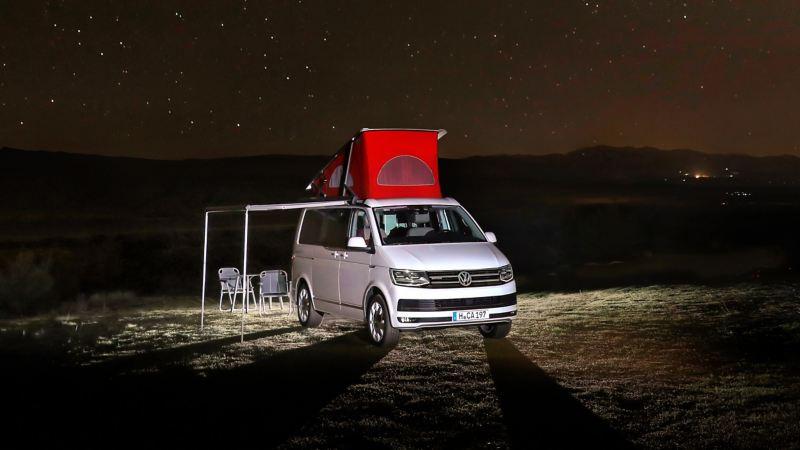 VW California camping under stars at night