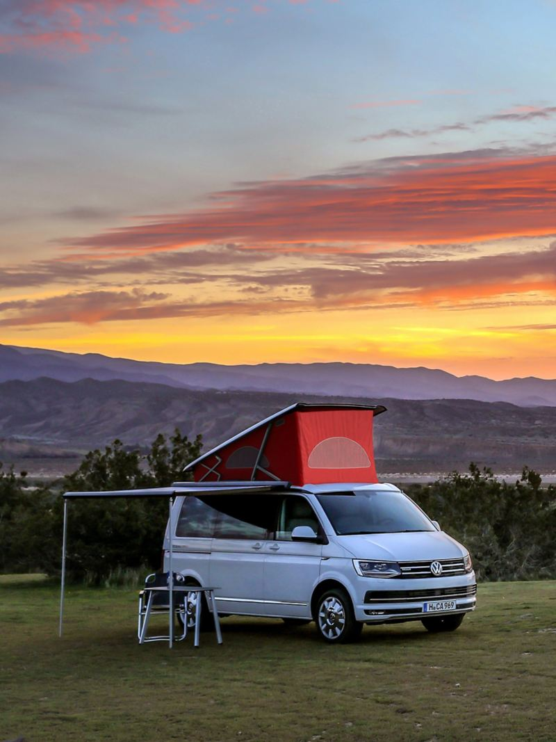 VW California parked under orange evening sunset