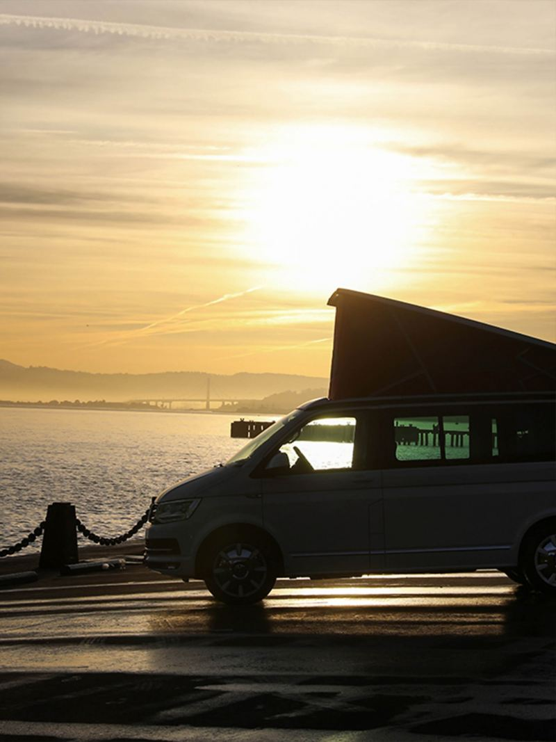 California van with roof bellow parked in the sun