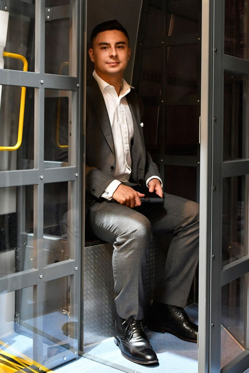 VW Crafter police riot van conversion holding cell with man sitting inside
