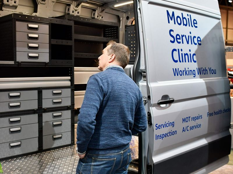 VW Mobile Service van with man looking inside van