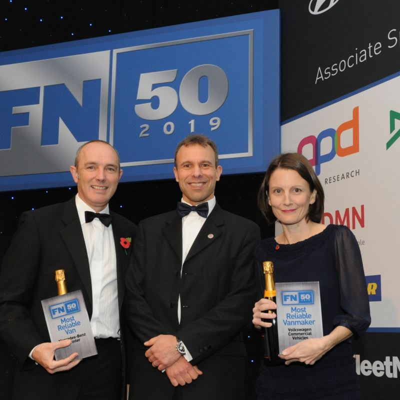 Fleet News editor and Volkswagen staff with awards during ceremony