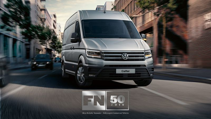 VW Crafter panel van in city with FN50 awards logo
