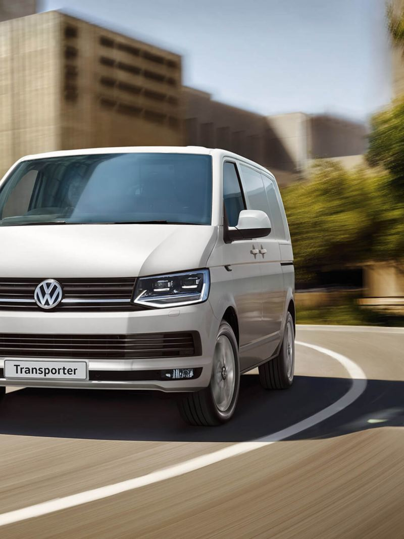 VW Transporter T6 convoy driving in city