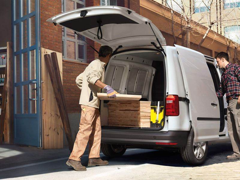Workmen securing load in a VW Caddy van