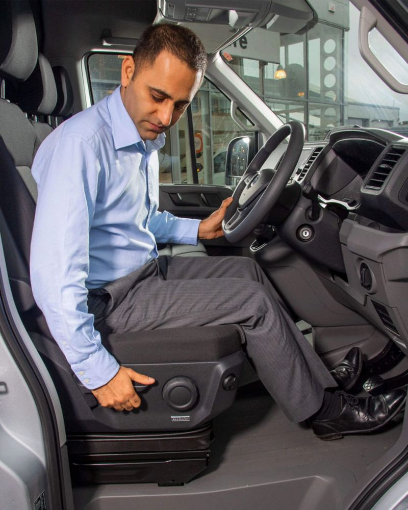Man in van adjusting seat