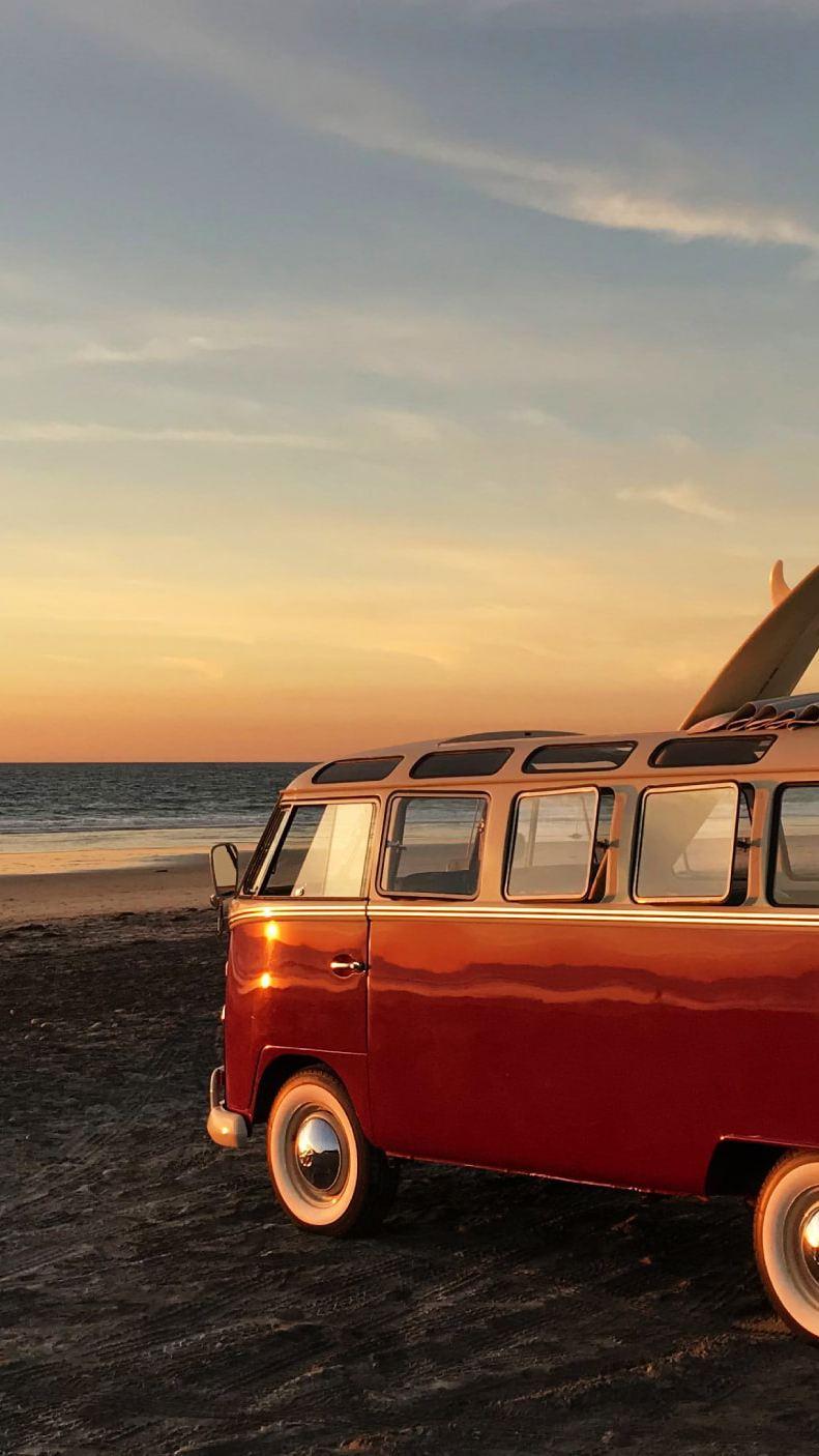 Volkswagen T1 camper van on beach at sunset