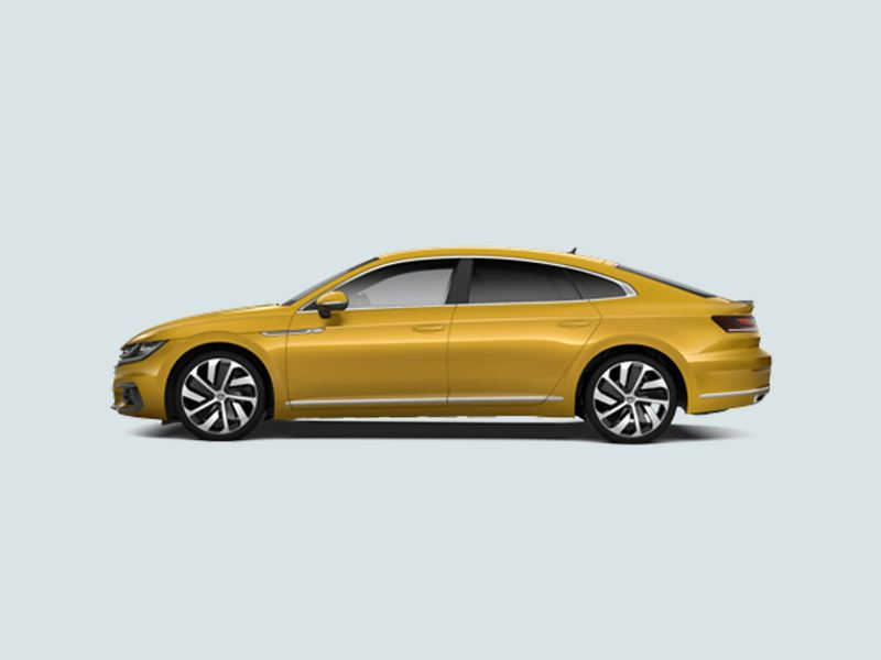 Profile view of a yellow Volkswagen Arteon.