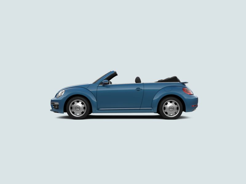 Profile view of a blue Volkswagen Beetle Cabriolet, with the soft-top roof down.