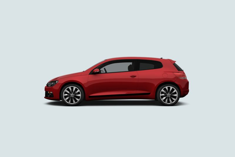 Profile view of a red Volkswagen Scirocco..