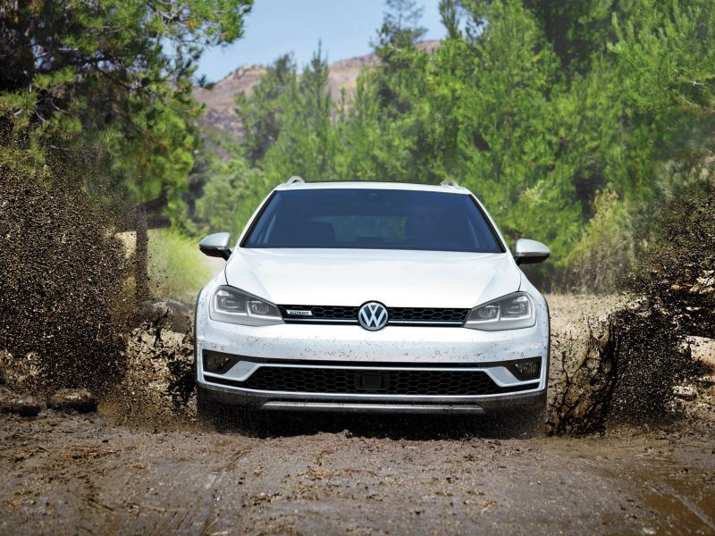 The Golf Alltrack driving in the mud with a raised suspension