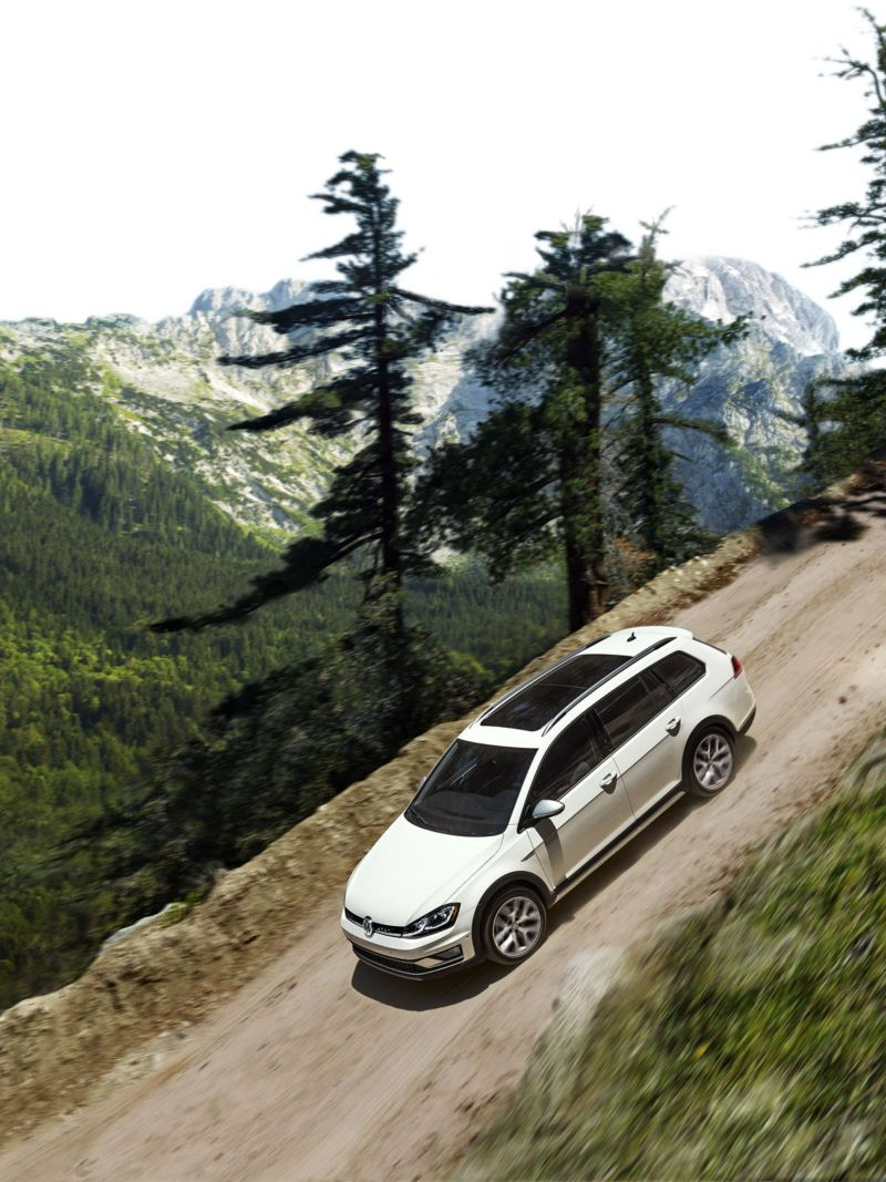Golf Alltrack driving down a mountain