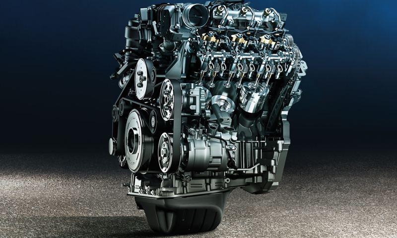 Grande plano de um motor artisticamente montado fora do VW Amarok.