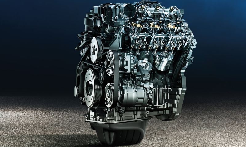 Wide shot of a stylishly presented engine without the vehicle.