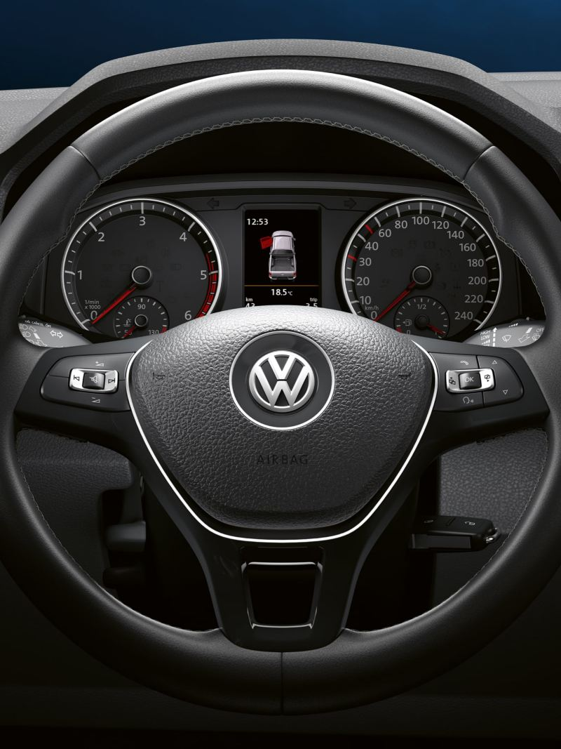 Wide shot of the leather-covered multifunction steering wheel with paddles.