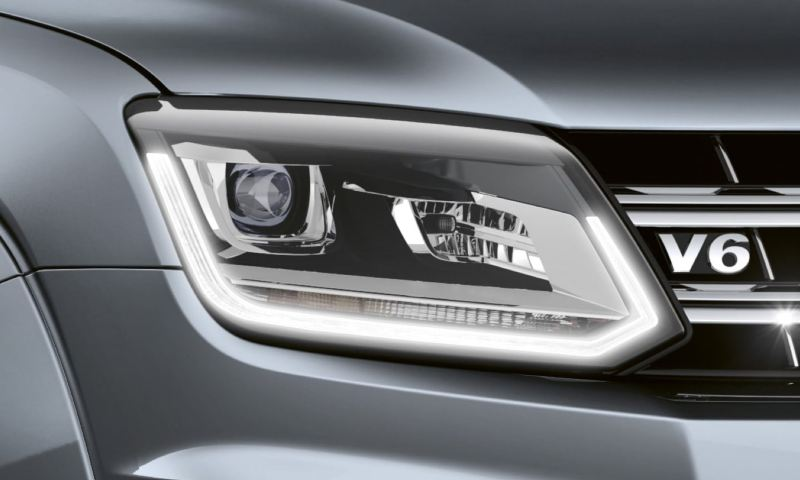 Detailed view of the bi-xenon headlights with the elegant lighting strip.