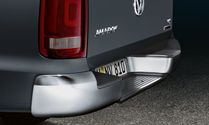 Detailed view of the partially chrome.plated rear bumper with built-in step.