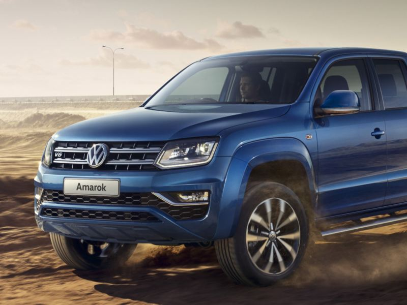 International pick up award Amarok v6 bleu 3/4 face ville
