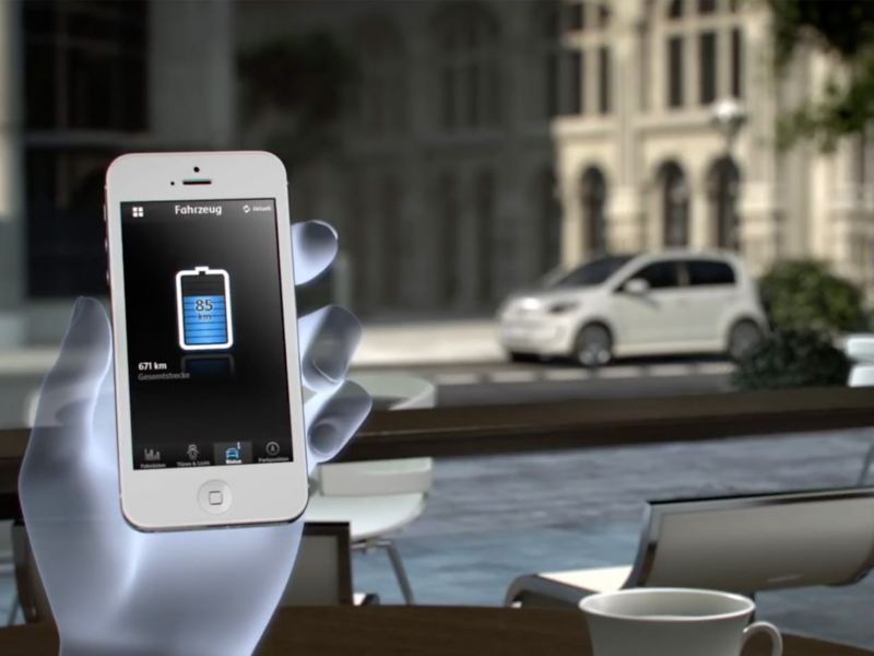 A translucent robotic hand holding a smartphone showing e-Remote.