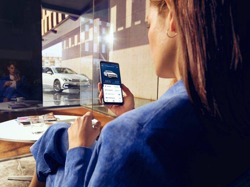 Woman looking at car configurator on phone
