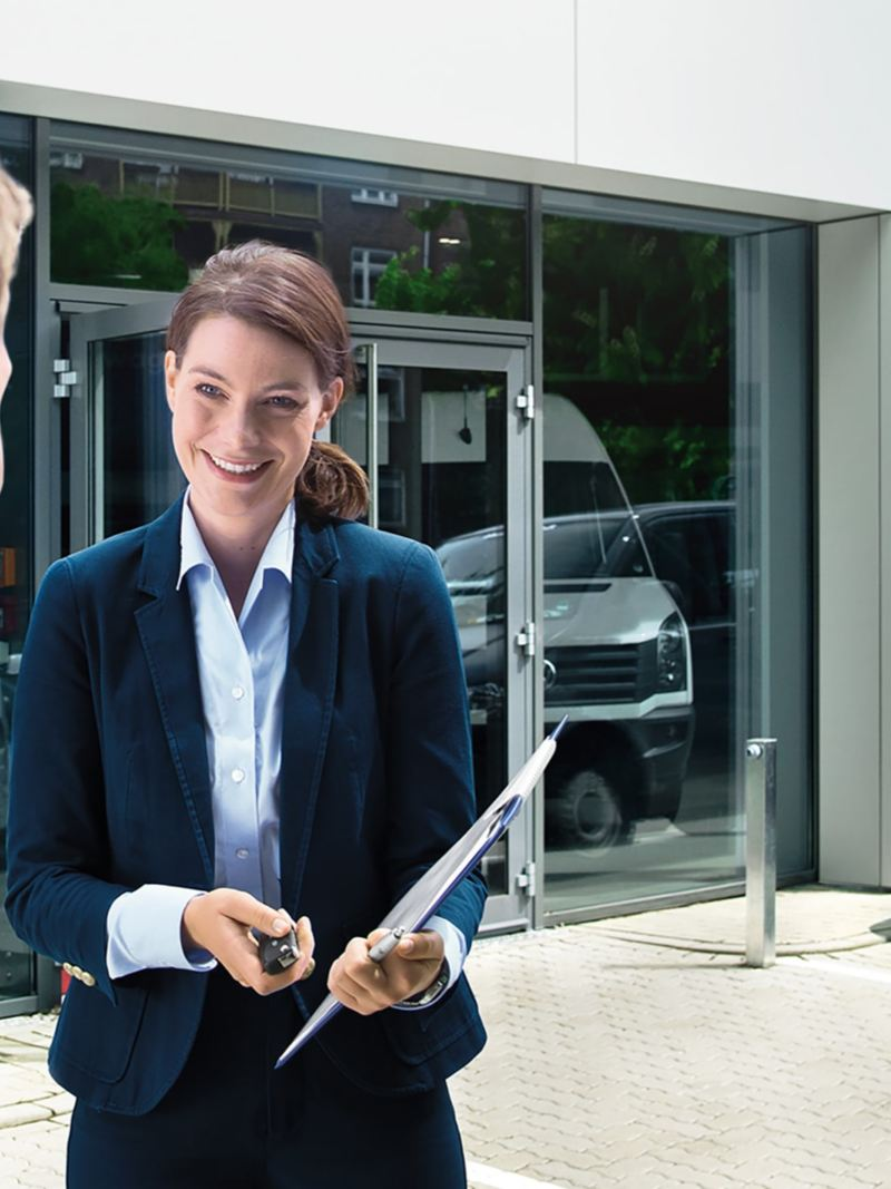 A VW Service Manager talking to a customer