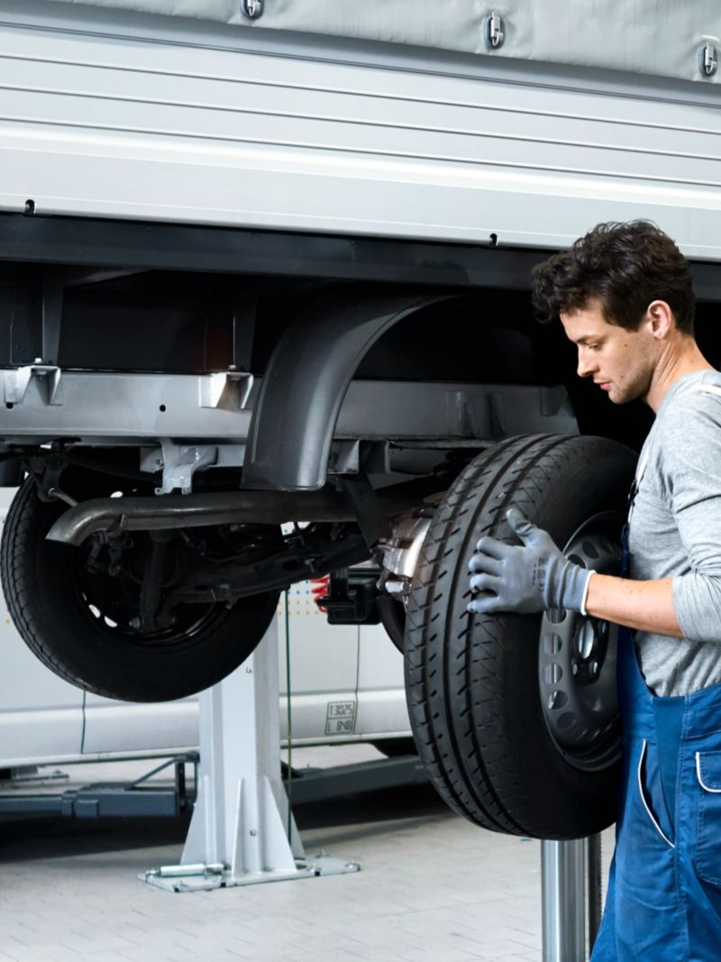 VW technician changing a wheel