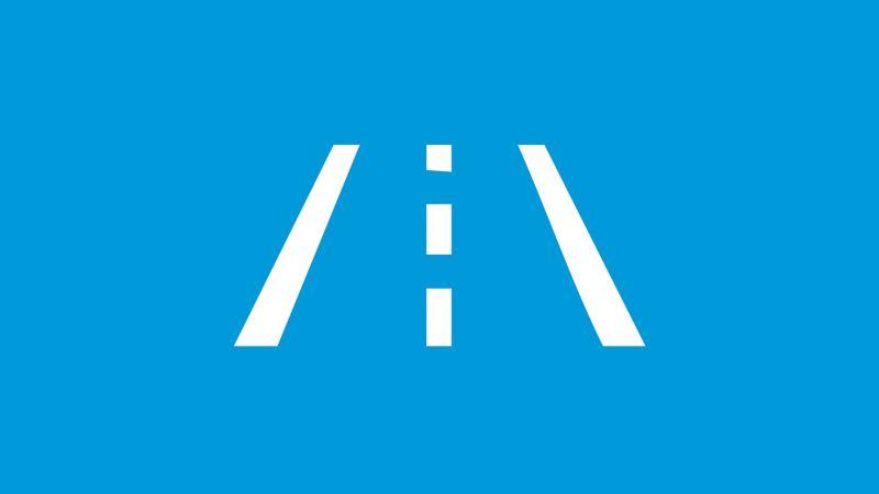 """Das Symbol des Spurhalteassistent """"Lane Assist"""" auf blauem Grund."""