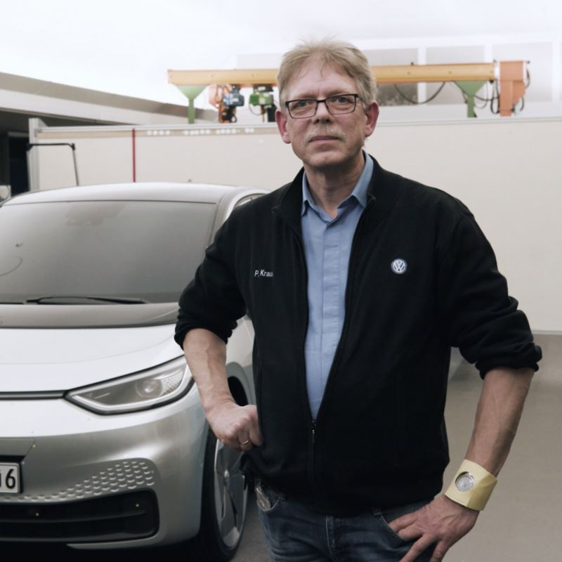 Peter Kraus in front of a car.