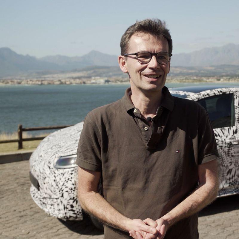 Frank Bekemeier in front of an Volkswagen ID.3 prototype