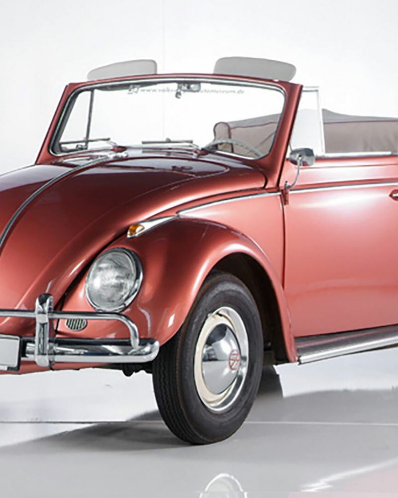 3/4 front view of a red VW Beetle Cabriolet