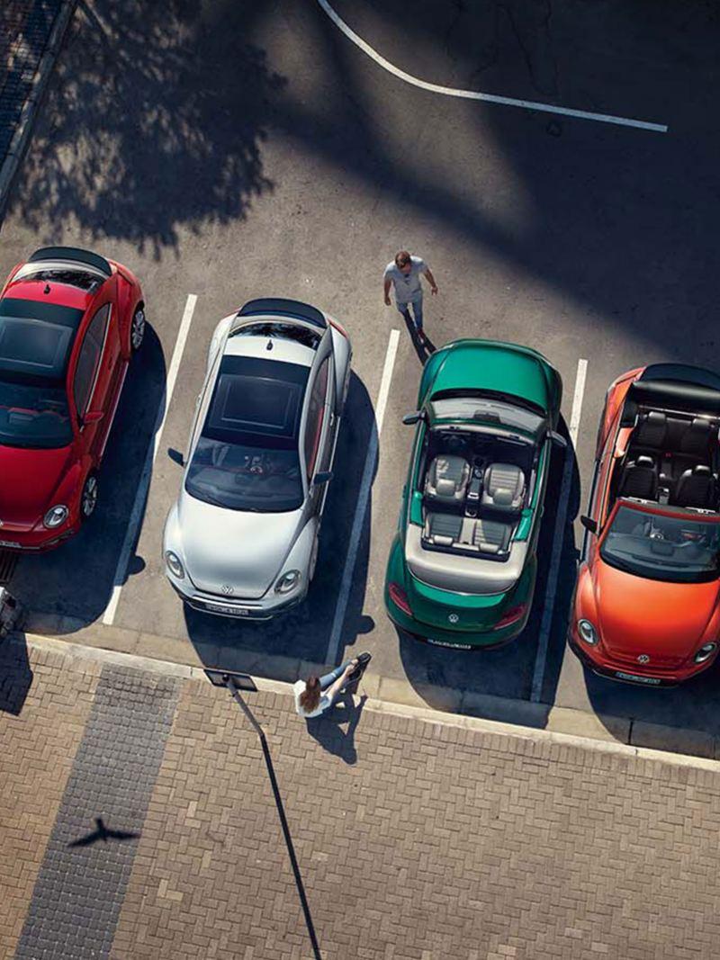Arial shot of 4 Volkswagen Beetle's.