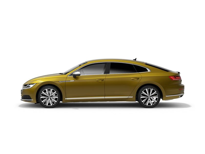A yellow Volkswagen Arteon from profile.
