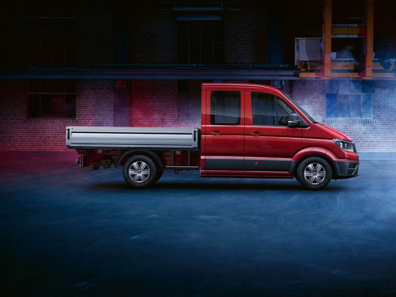 VW Crafter chassis cab in studio with blue fog background