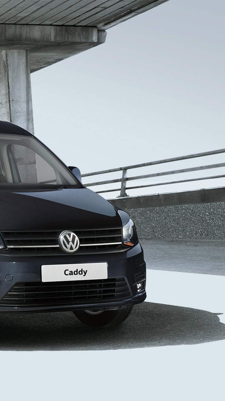 Volkswagen Caddy van under flyover