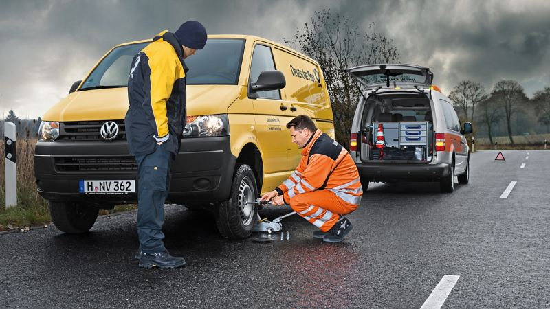 Van technician fixing van roadside
