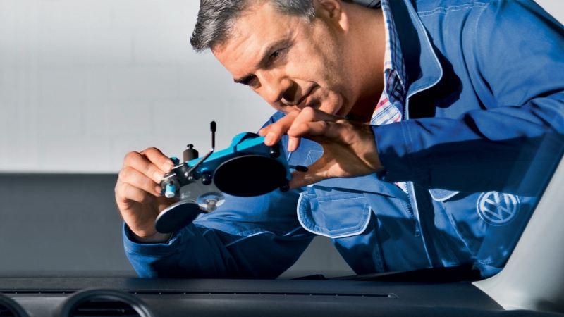 Volkswagen Commercial Vehicles technician repairing a van's windscreen