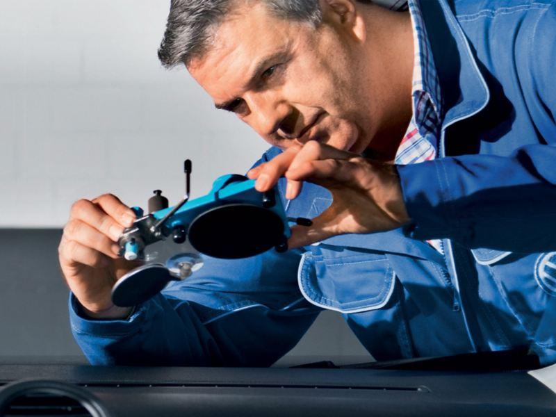 Van technician inspecting windscreen