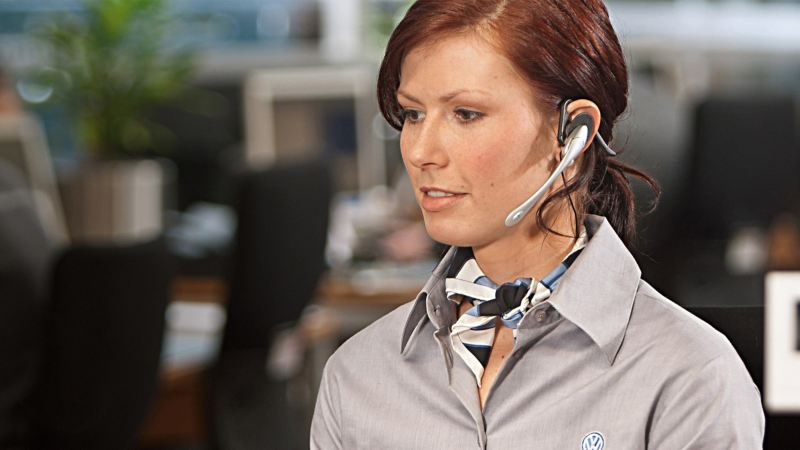 Woman on headset at desk