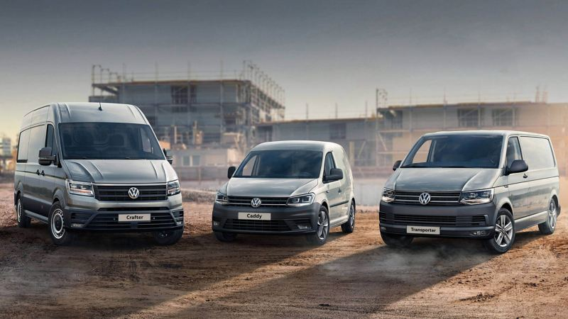 Fleet of VW vans with construction site in the background