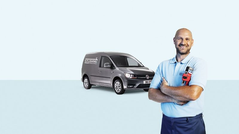 Trained technician in front of VW van