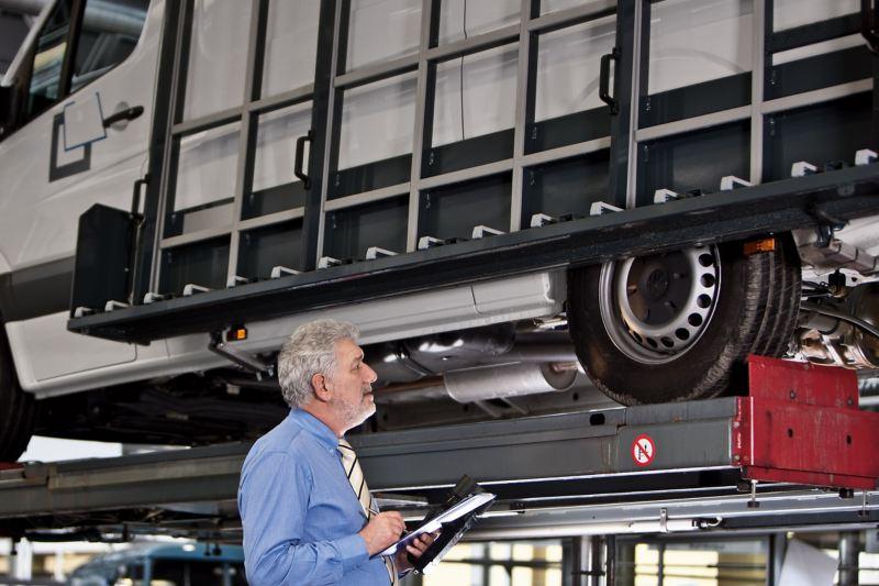 technician inspecting a VW van in Van Centre
